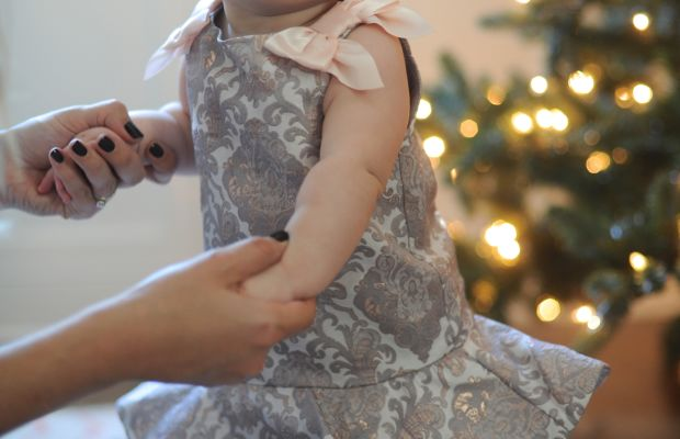 Tip toes by the tree in a metallic jacquard dressby Janie and Jack.