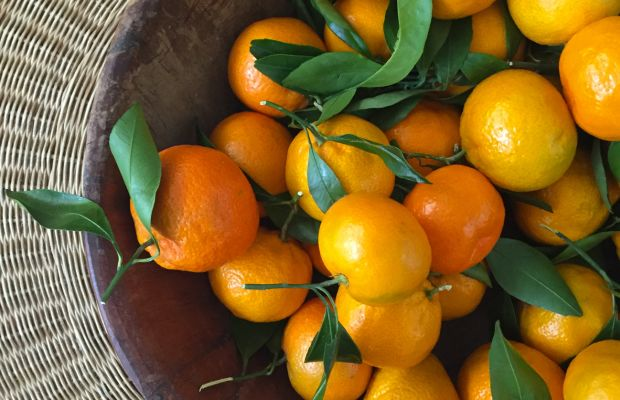{Clementines as a colorful/edible centerpiece on our coffee table}