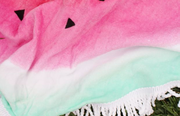 {An adorable watermelon picnic blanket for outdoor gatherings}