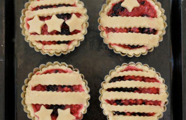 {Miniature mixed berry tarts}