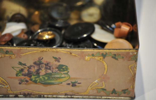 {A vintage box that holds all of her buttons.}