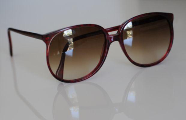 {Deep burgundy-colored vintage sunglasses}