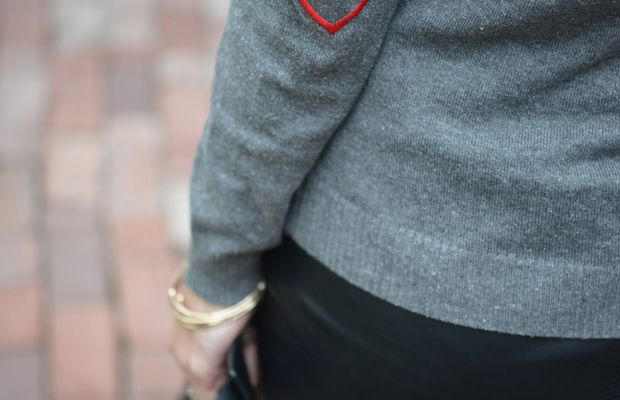 {A sweater with heart elbow patches}