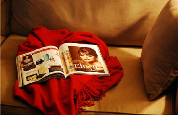 {Cashmere throw and a magazine}