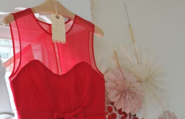 {I loved the sheer fabric and ruching on this red party dress}