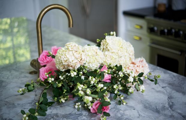 {Kitchen sink filled with flowers for a book shoot}