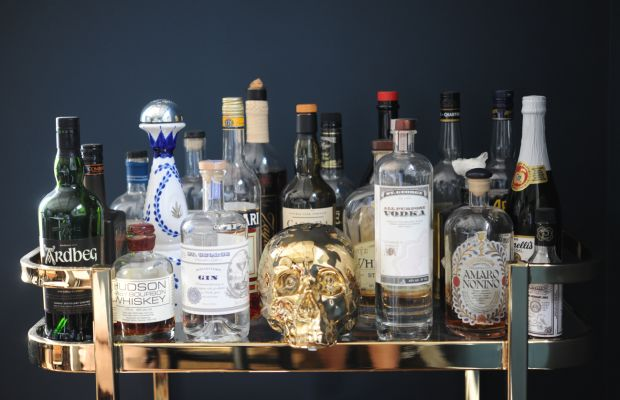 {Gold skull to accent our bar cart}