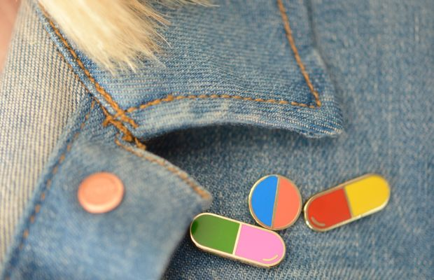 {Pill pins by Georgia Perry, on a denim jacket that's definitely too hot to wear just yet}