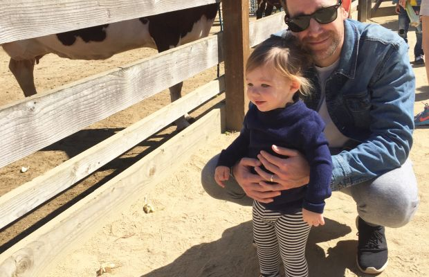 {Sloan mesmerized by the animals at the petting zoo}