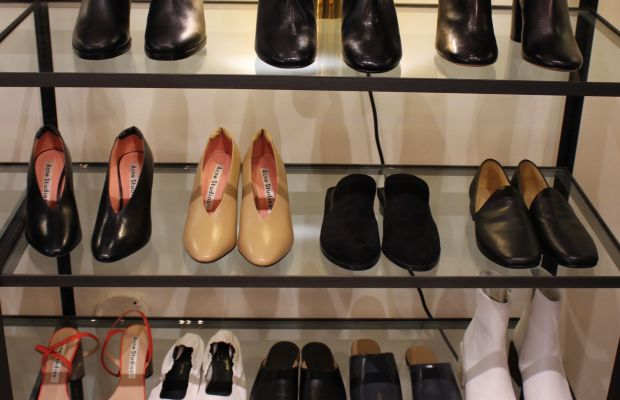 {I've been eyeing the Acne mule/bootie hybrid on the second shelf from the top, in camel}