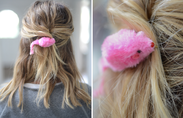 {A playful touch to a simple updo: Cali's favorite mouse toy affixed to a hair clip}