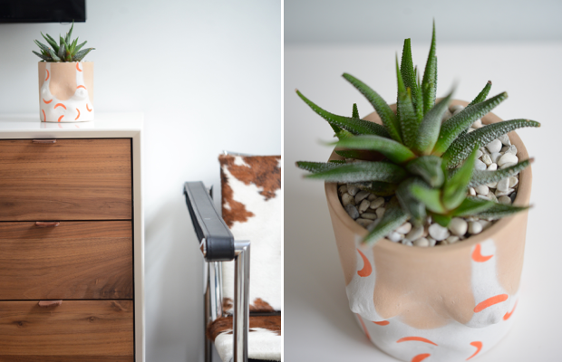 {A cheeky planter that adds a fun(ny) touch of green to the console}