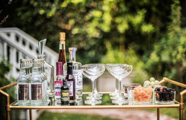 {Cocktail bar packed with botanical gin and rose-infused syrups}
