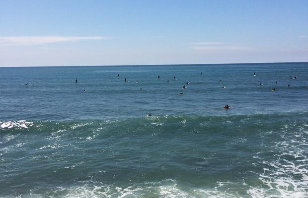 {Tiny surfers dotting the water in Malibu}
