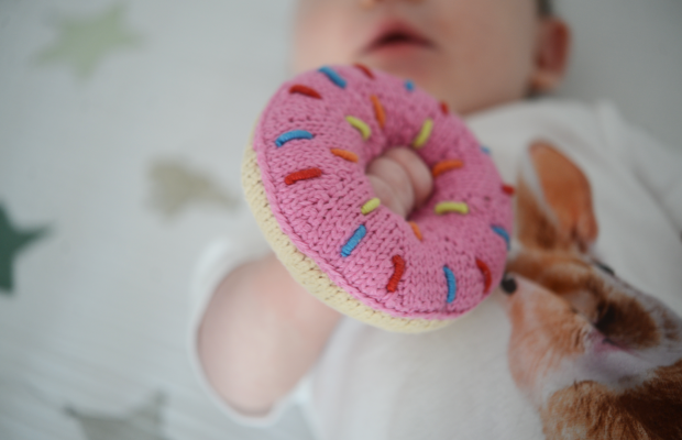 {Sloan shares our appreciation for donuts with her rattle}