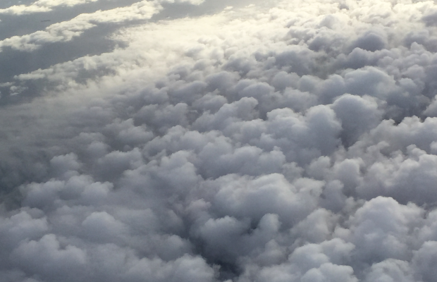 {Pillowy clouds on my flight into New York}