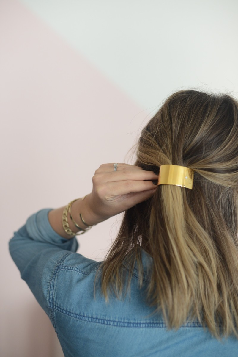 {The prettiest gold clip that eliminates a bad hair day. Similar version from J.Crew here}