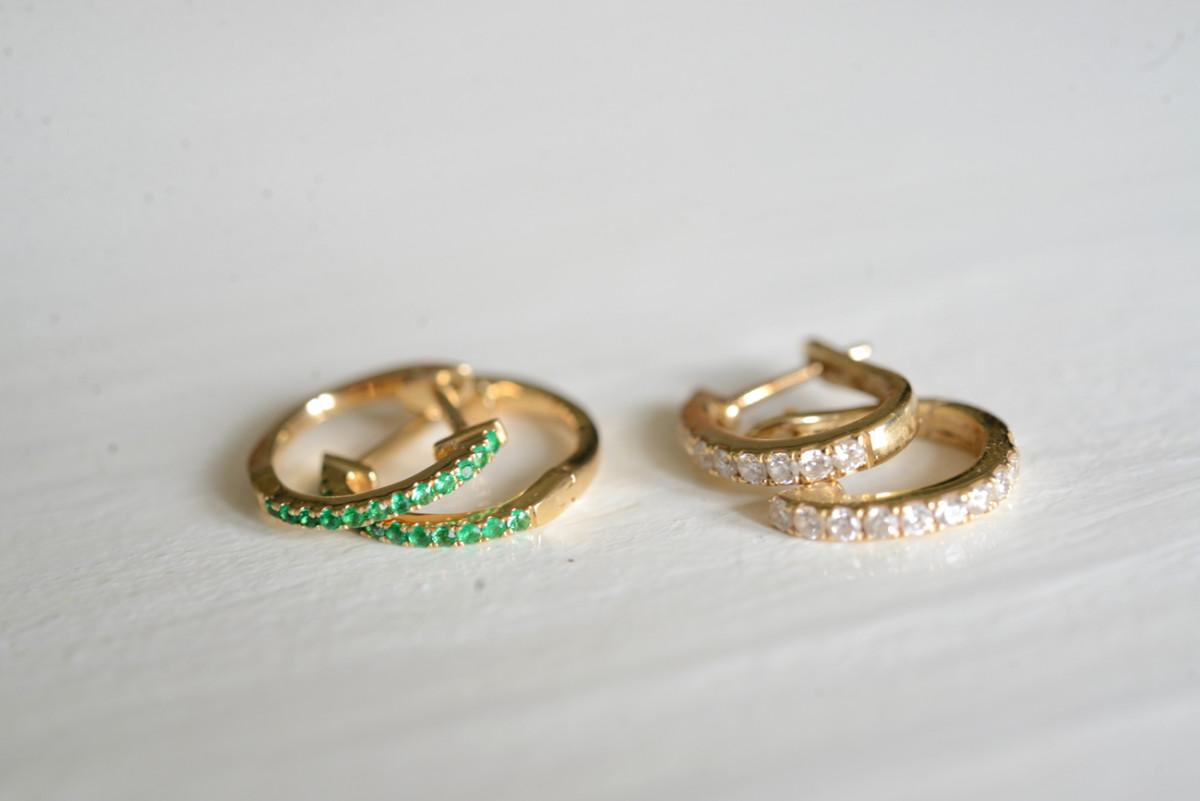 Left to right: Ariel Gordon emerald huggies c/o, XIV Karats diamond huggies
