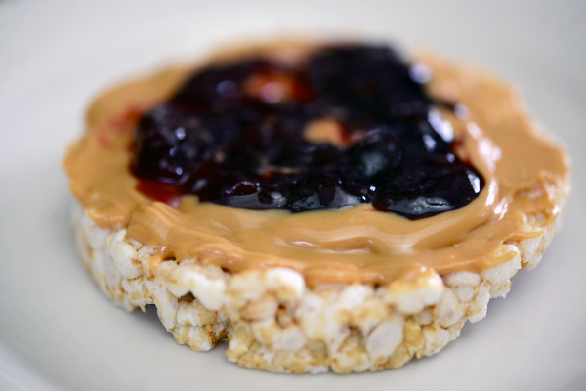 {Monday's snack: brown rice cake with peanut butter and jelly}