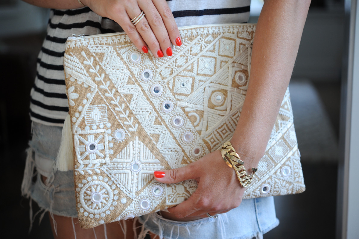 {An oversized embroidered clutch with mirrored paillettes}