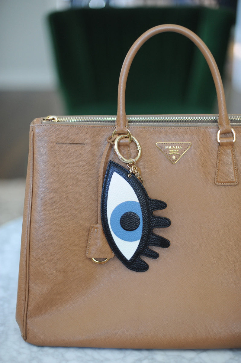 {An eye charm that brings life to an old purse}