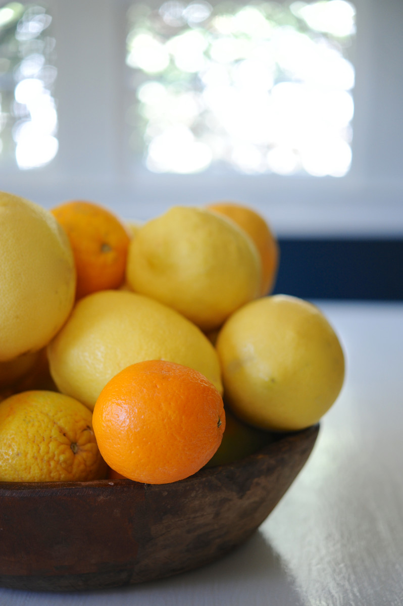 {Overflowing bowl of citrus}