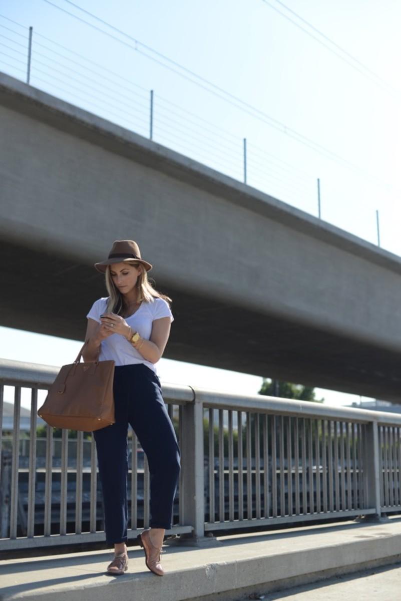 J.Crew Hat (similar here), James Perse T-shirt, J.Crew Pants, Prada Purse, Michael Kors Watch, Madewell Oxfords