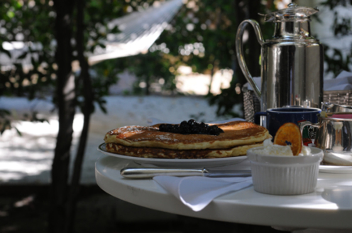 {I loved eating breakfast out on our patio, complete with our own hammock. I ordered blueberry pancakes with devonshire cream.}