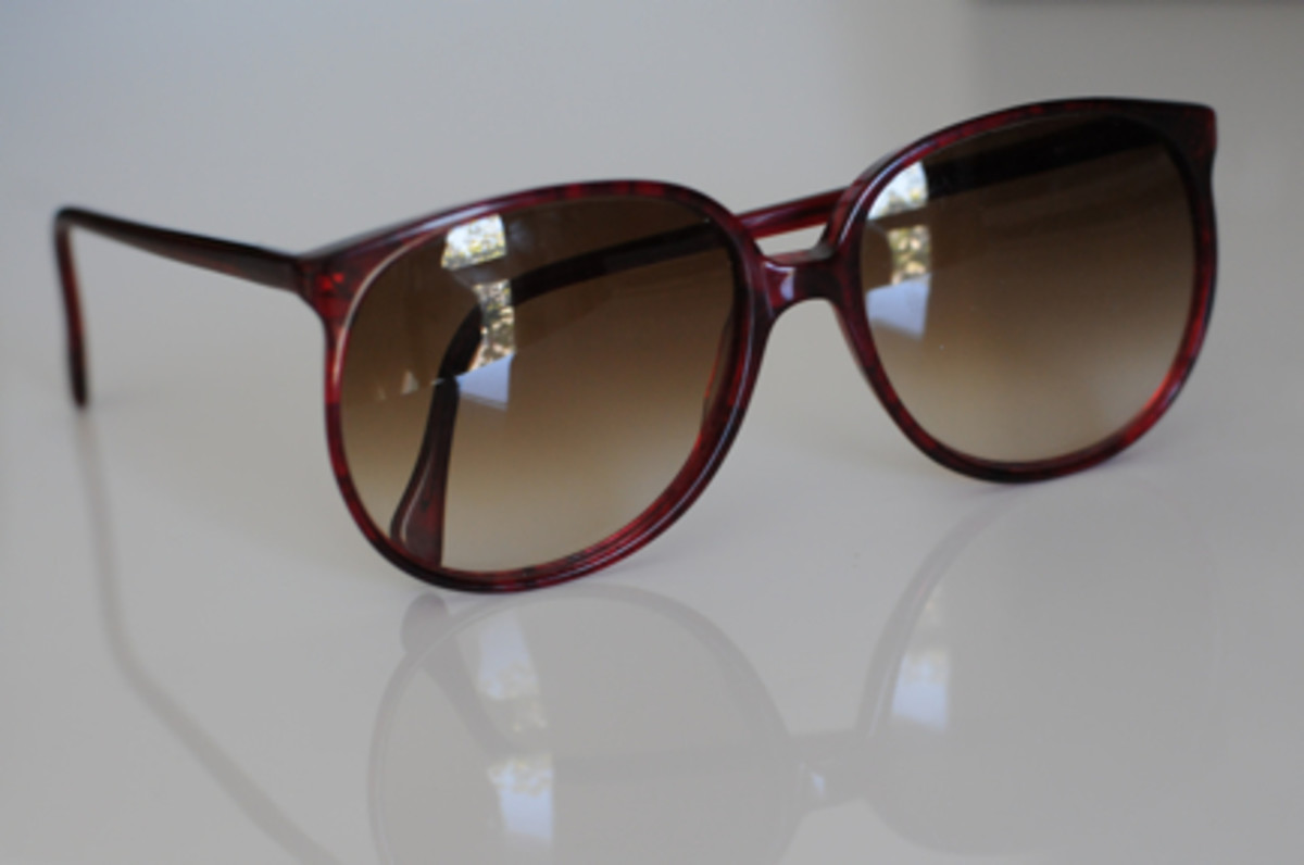 {Deep burgundy-colored vintage sunglasses}