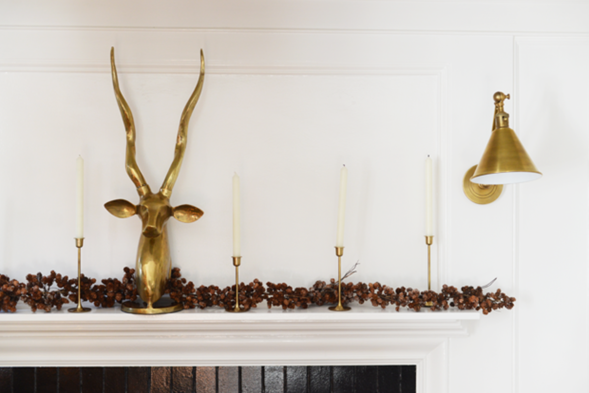 {Brass and pinecone mantel}