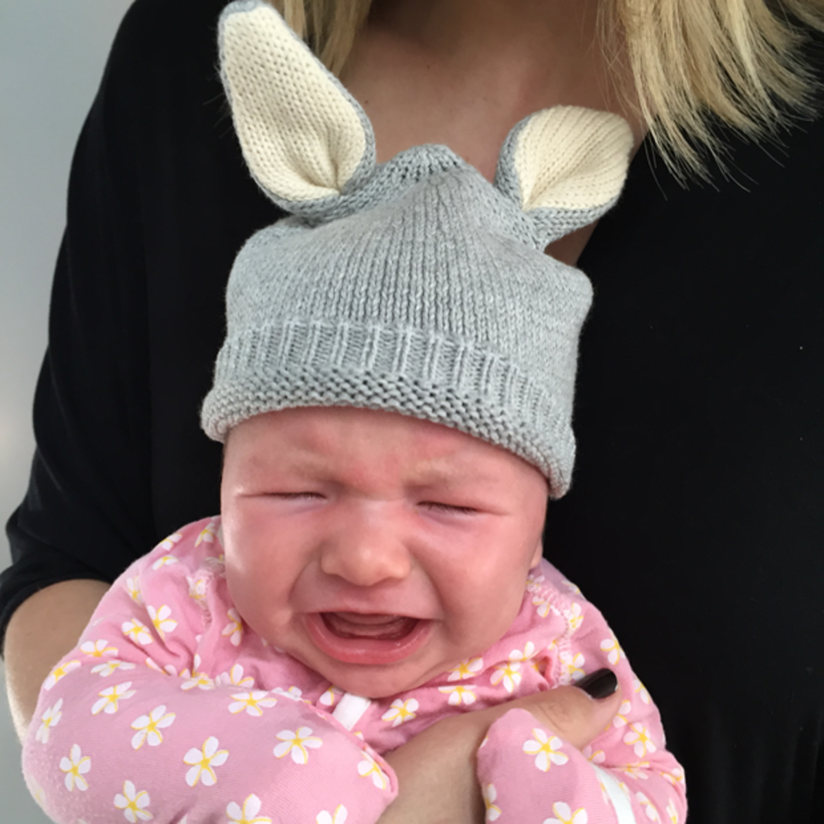 {Sloan, clearly not feeling her bunny ears}