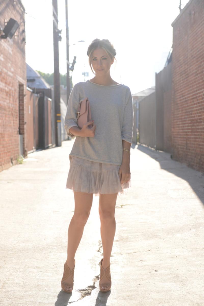 Levi's Sweatshirt,LoveShackFancy Skirt, Balenciaga Clutch, Prada Shoes