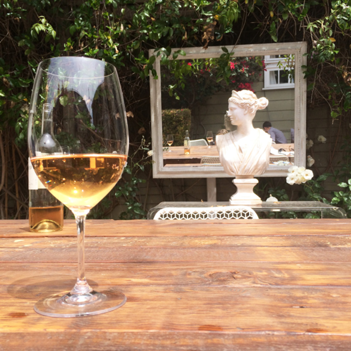 {Enjoying a glass of rosé in our backyard}