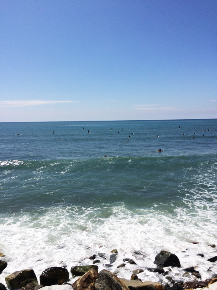 {Tiny surfers dotting the water in Malibu}