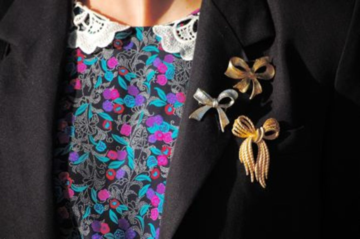 {A collection of vintage bow pins spice up an old blazer}