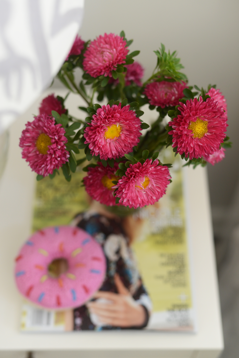 {Pretty side table: flowers + donut rattle}