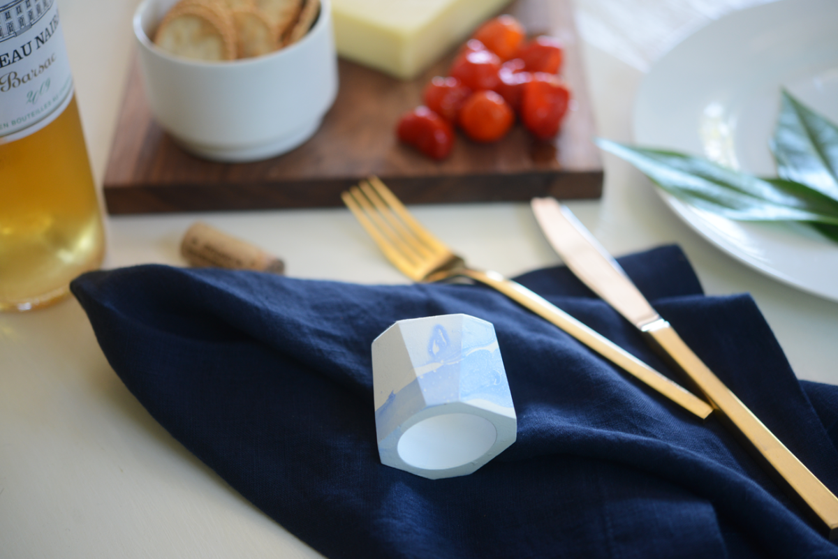 Crate & Barrel indigo linen napkins, West Elm gold flatware