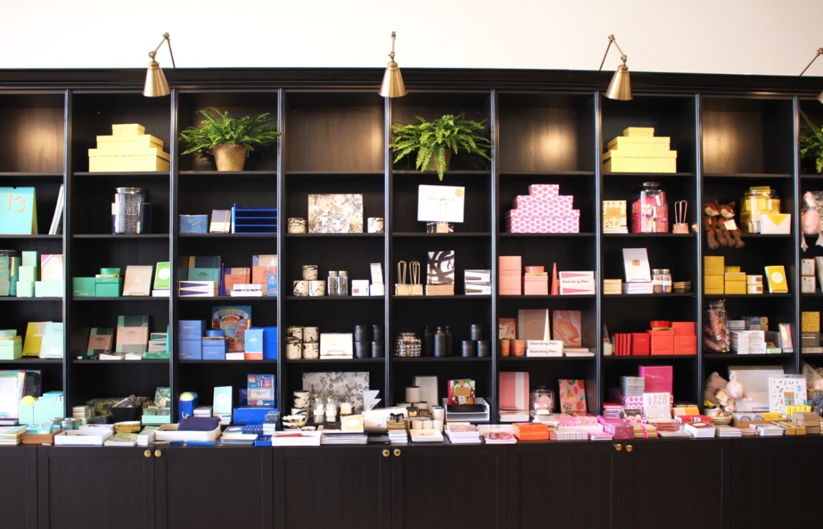 {An incredibly appealing rainbow display of paper goods at The Social Type}