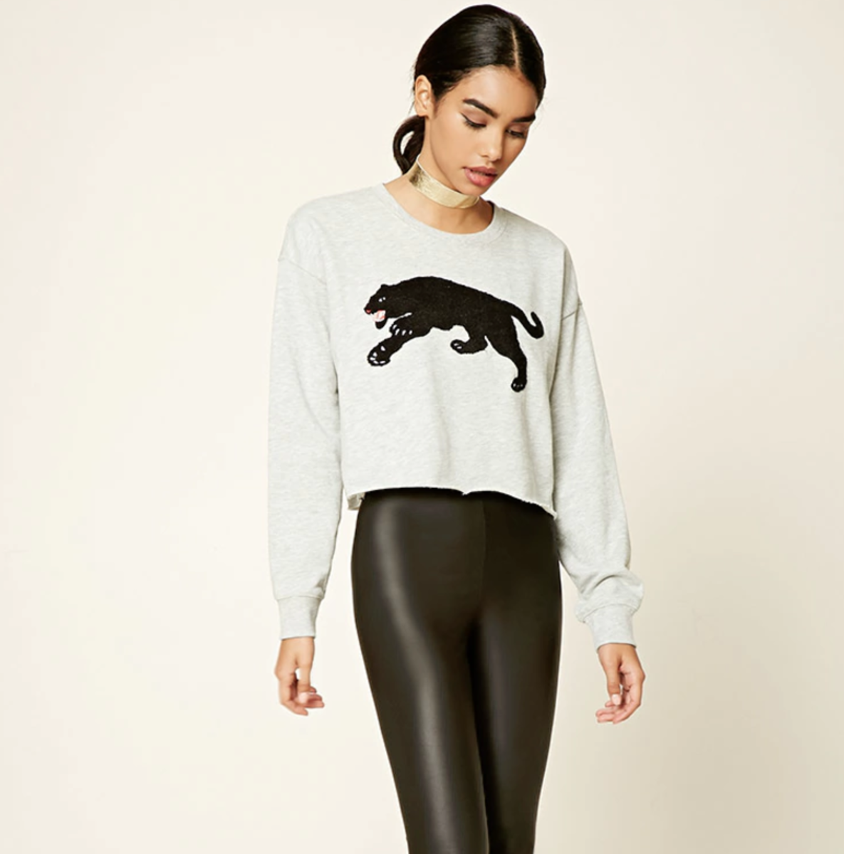 Shop the Item: Graphic Panther Sweater ($17) - This would make jeans and sneaks feel a bit more fun