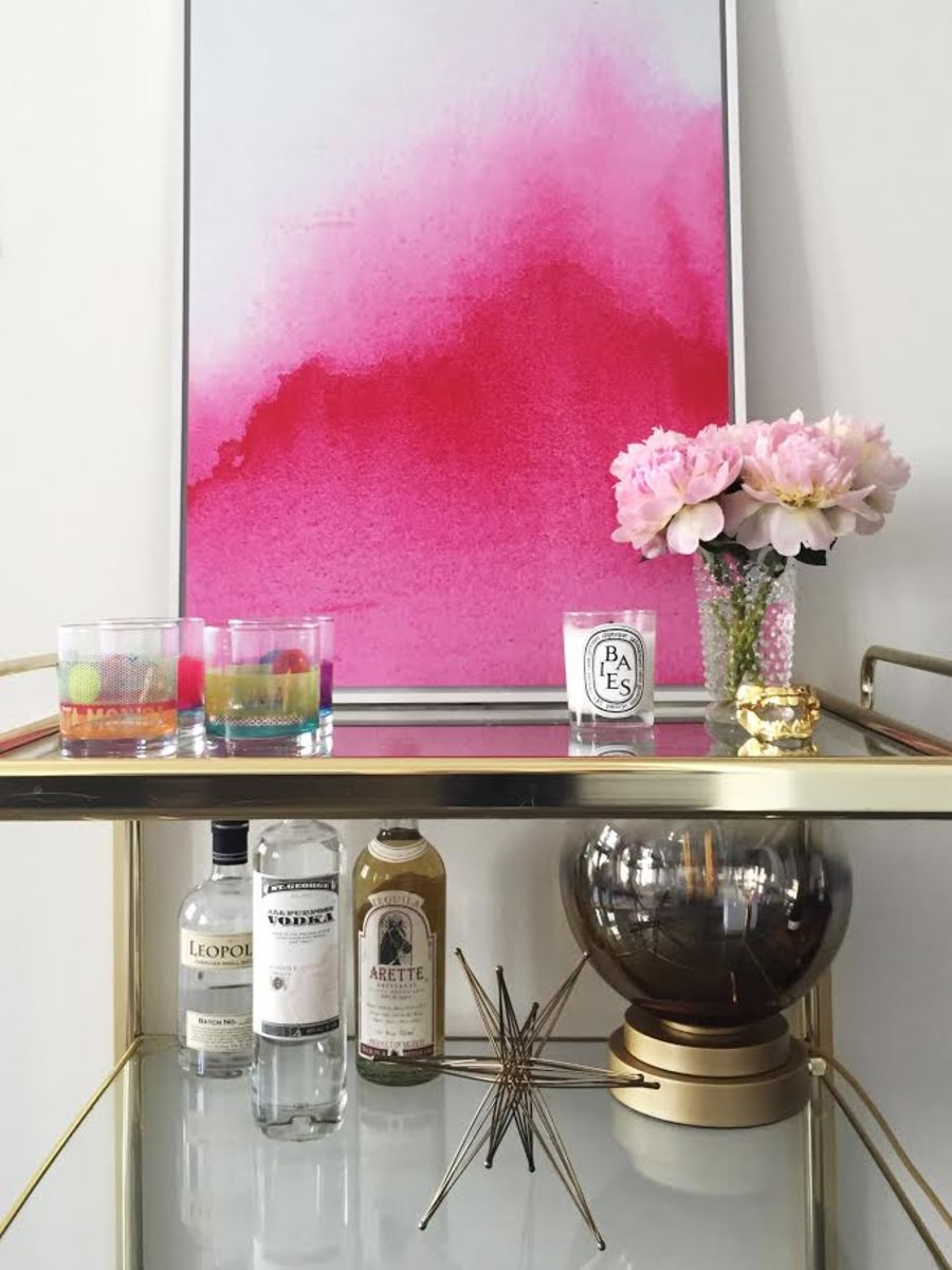 {Our bar cart currently, with one of my favorite ombre gold lamps}