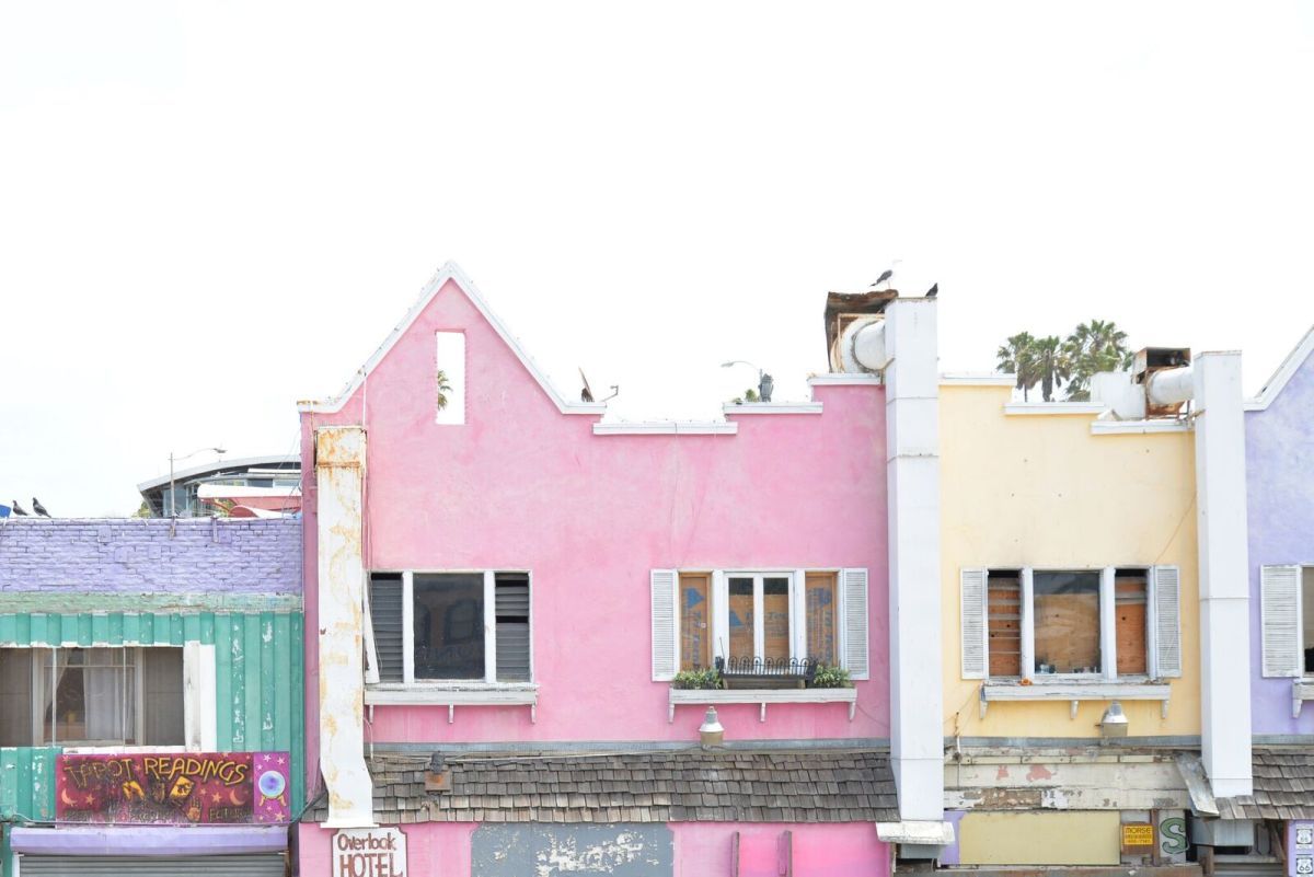 {Pastel buildings on a foggy beach morning}