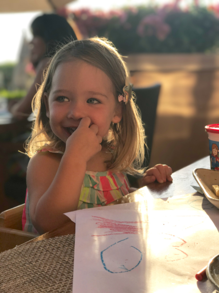 {The happiest girl during an al fresco dinner date}