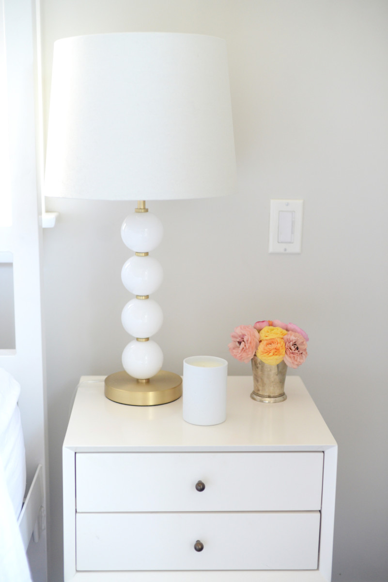 {A sunset palette of flowers that dressed up my bedside table this week +Cupcakes and Cashmere lamp}