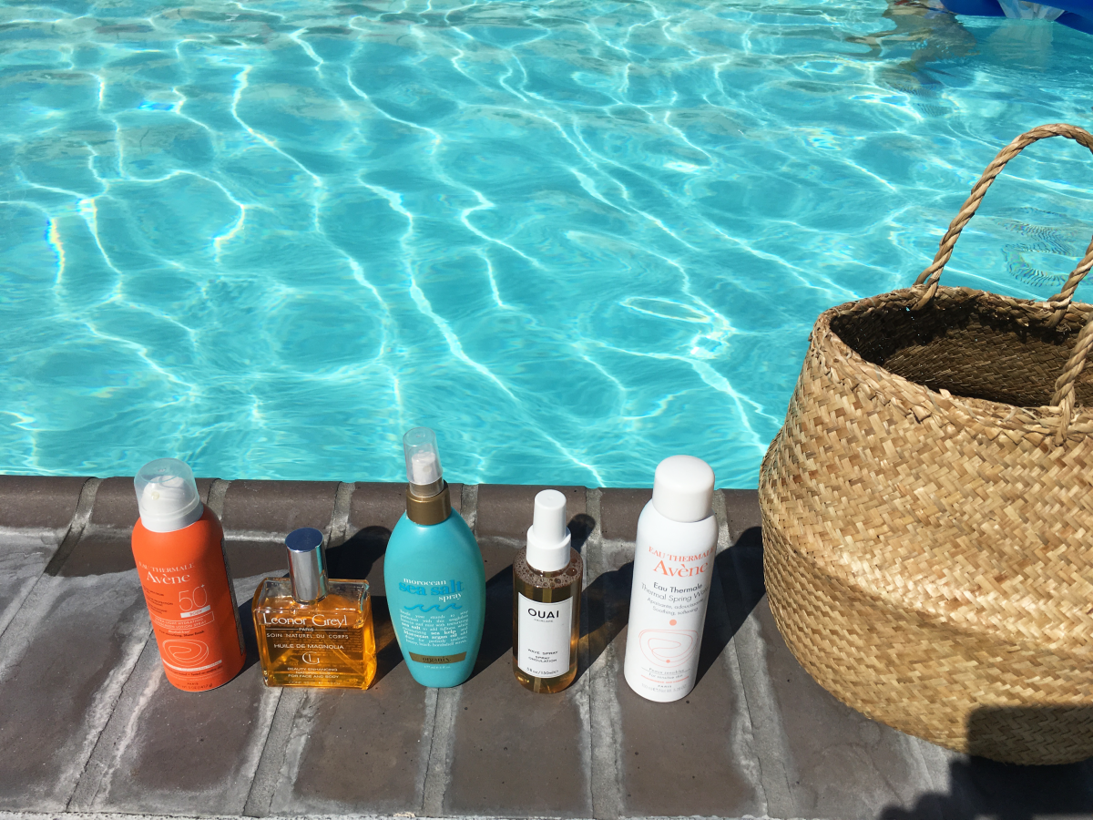 My pool line-up: Avene Hydrating Sunscreen Lotion Spray SPF 50, Leonor Greyl Huile de Magnolia for Face and Body (I am obsessed with this stuff), OGX Moroccan Sea Salt Spray, Ouai Haircare Wave Spray, Avene Thermal Spring Water Spray (which I spray after sun exposure to soothe skin), Doen Market Carry-All Basket (currently sold out, but similar here)