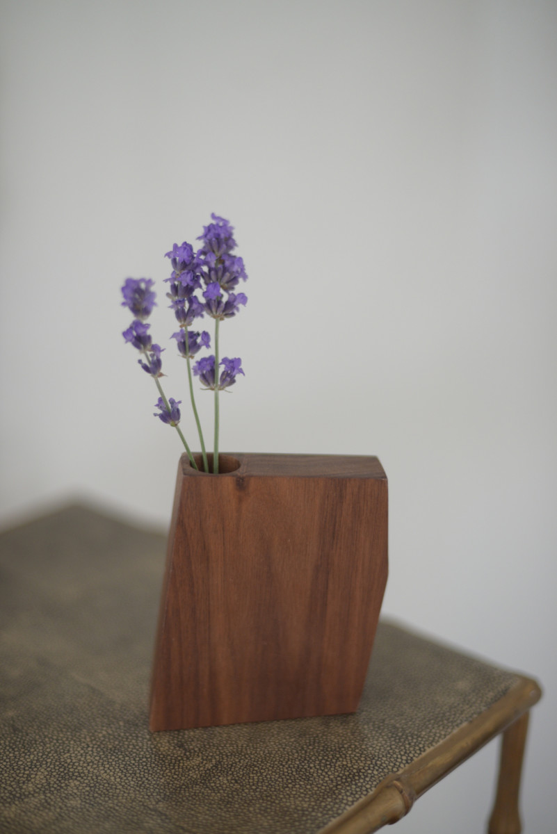 A miniature wooden vase from Boyce Studio that holds little buds