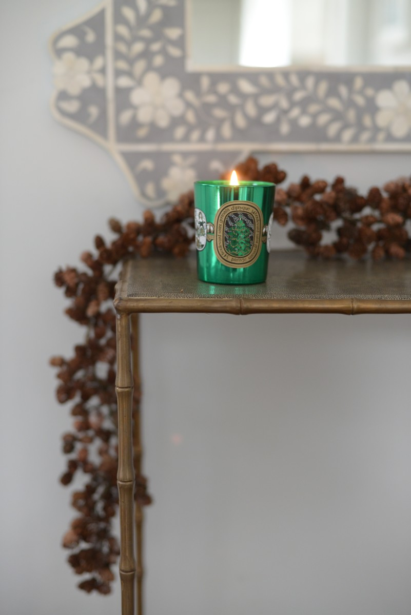 {Diptyque's holiday candle filling our home with the best scent}
