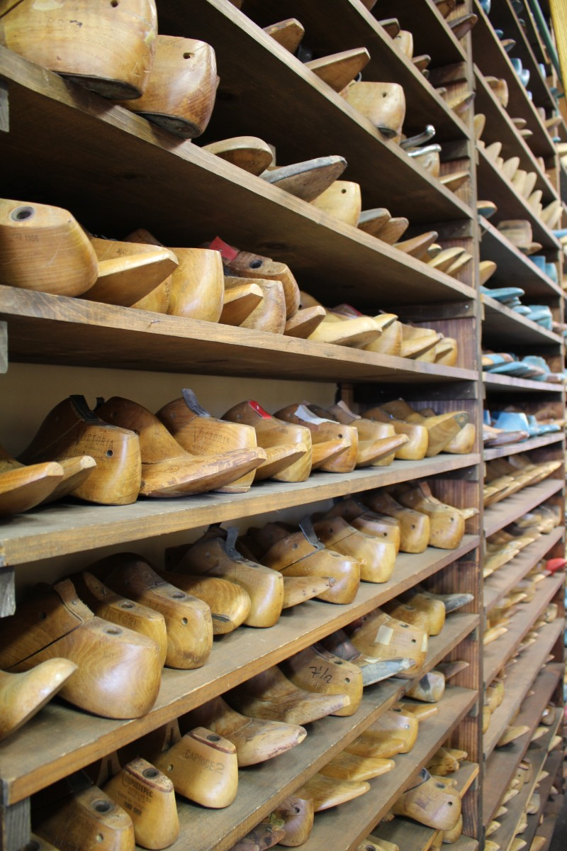 {An oddly beautiful wall of cobbler's shoes}