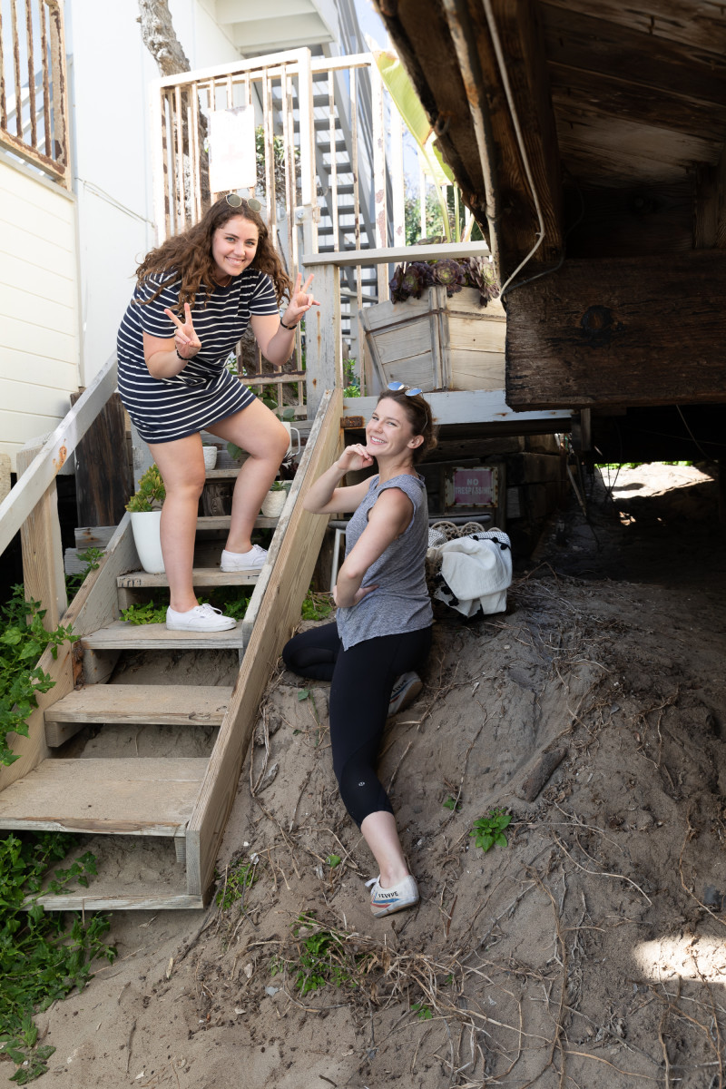 Hannah and Leslie prop-styling / posing on stairs heading to the beach