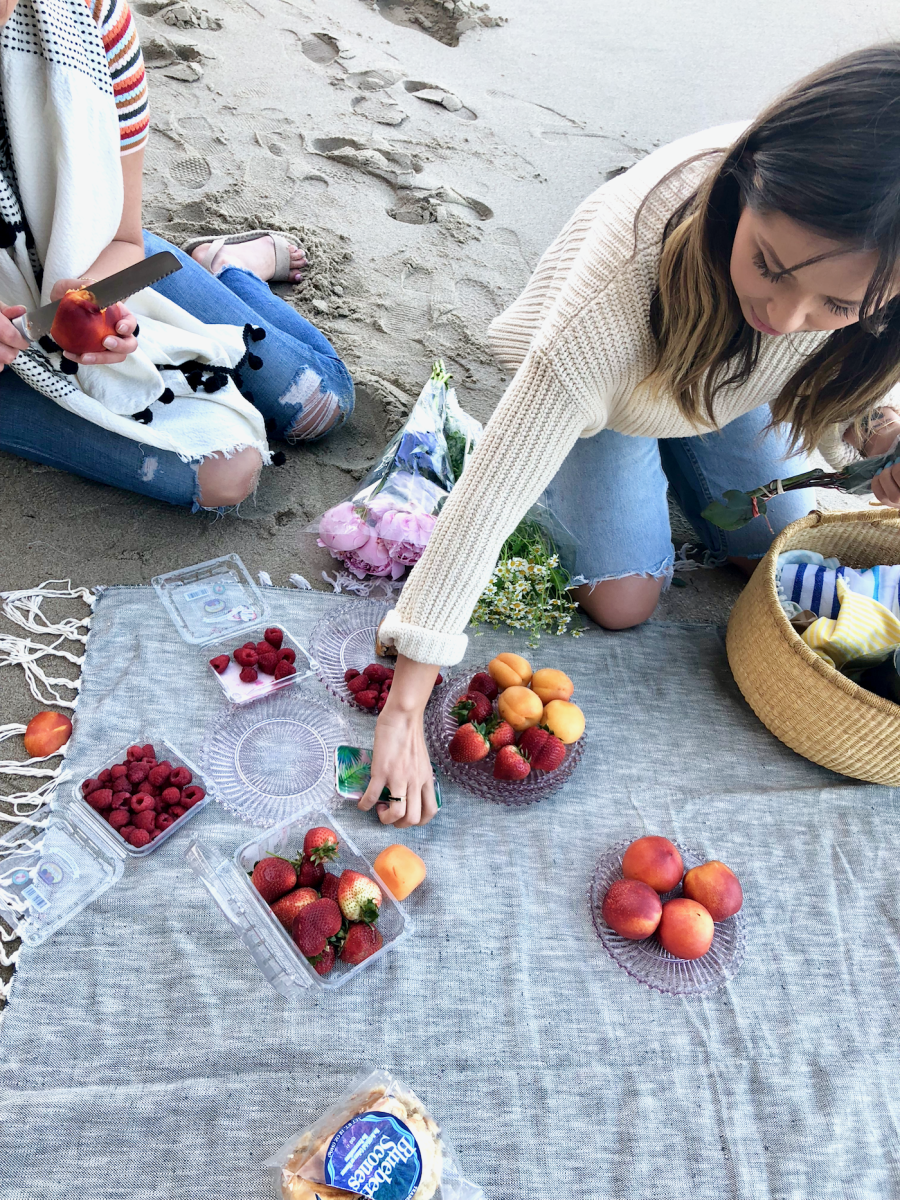 Our Shop team, setting up a picnic for a scene