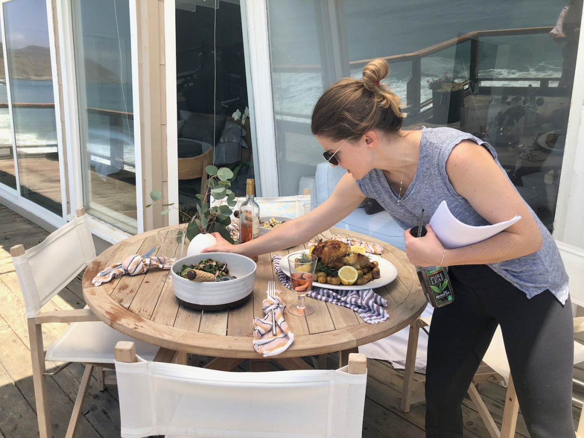 Leslie in her element, food styling an outdoor entertaining scene